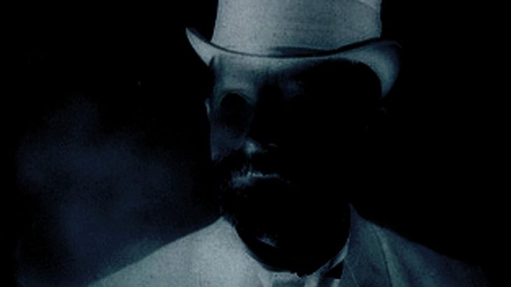 A shadowy figure wearing a top hat