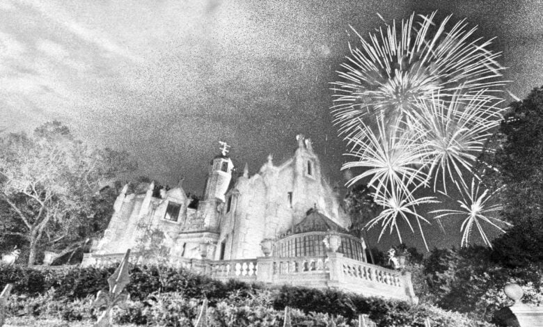 The Haunted Mansion at Walt Disney World with fireworks in background