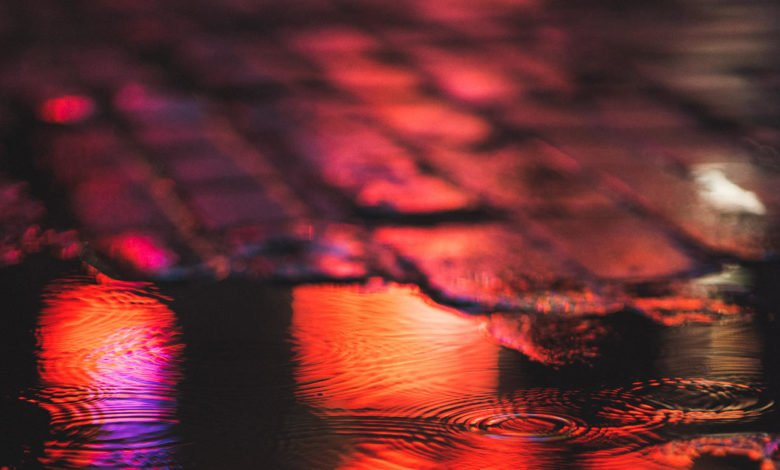 Red rain pooling on concrete