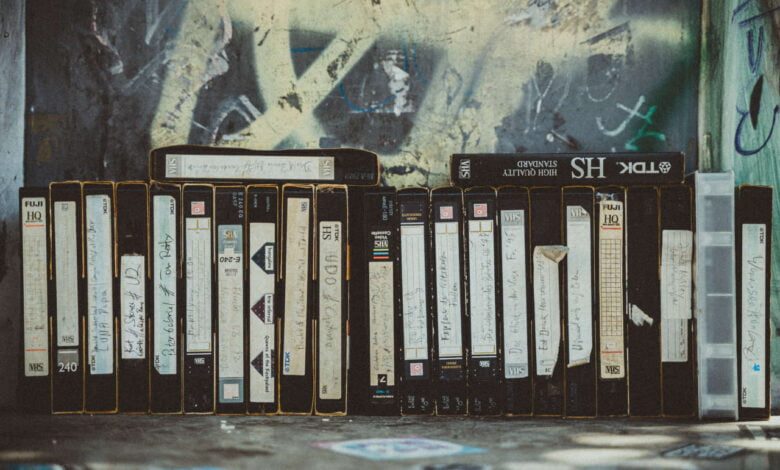 A row of VHS cassette tapes