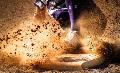 A baseball player sliding to base