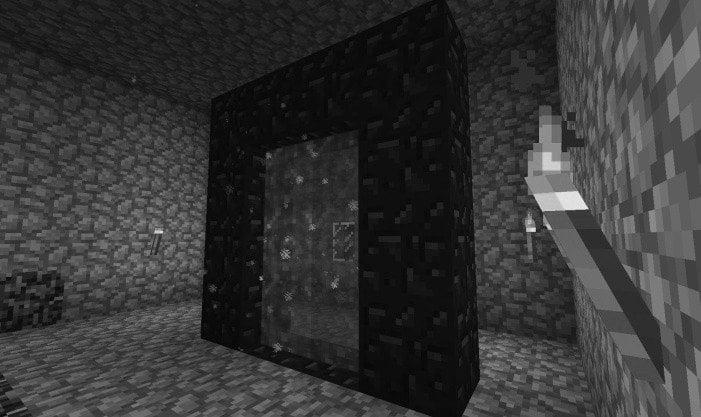 An ender portal made of obsidian blocks in Minecraft