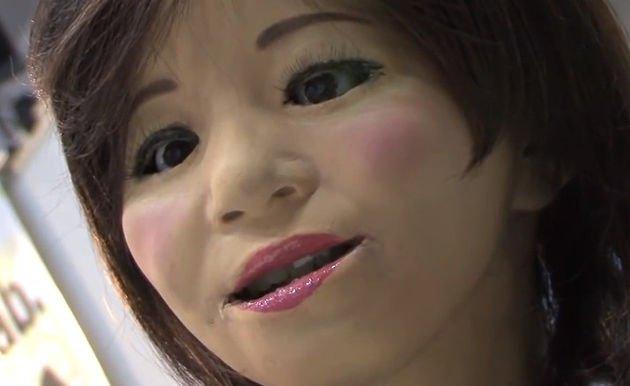 The reception robot has makeup and lifeless eyes