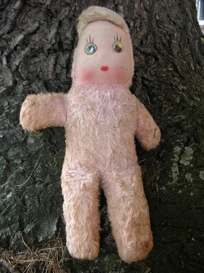 An abandoned doll near a tree