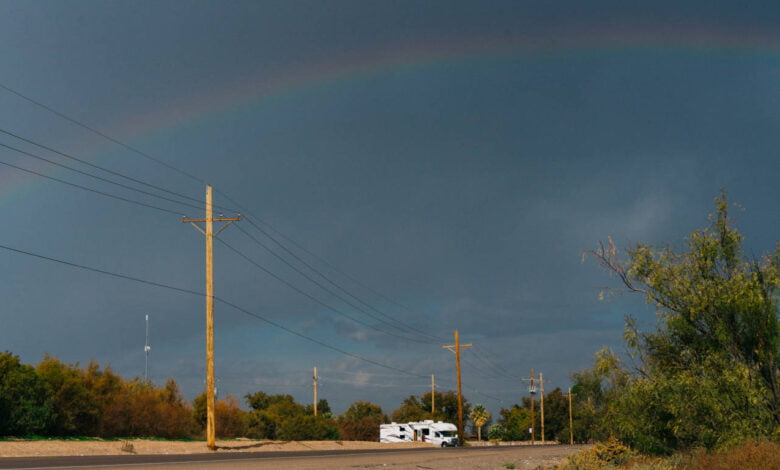 A lonely road in Texas under a rainbow