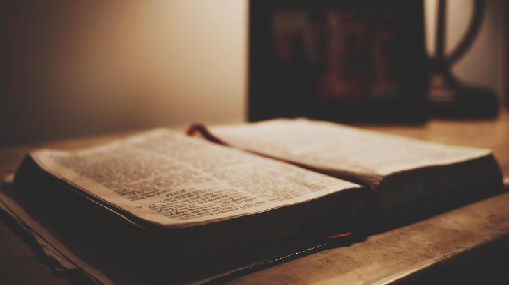 A Bible sits on a desk