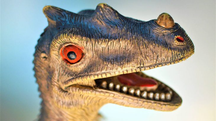 A toy dinosaur smiles for the camera