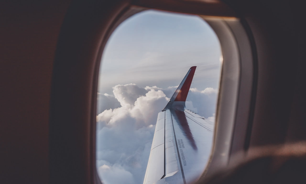 The view from inside an airplane, looking out at its wing