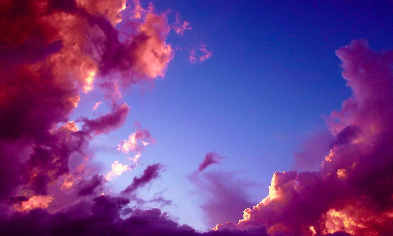 Strange purple clouds in a blue sky