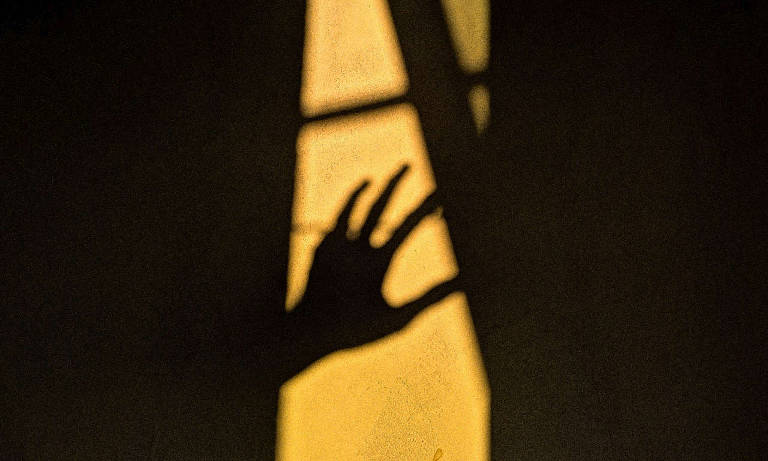 The shadow of a hand reaching out