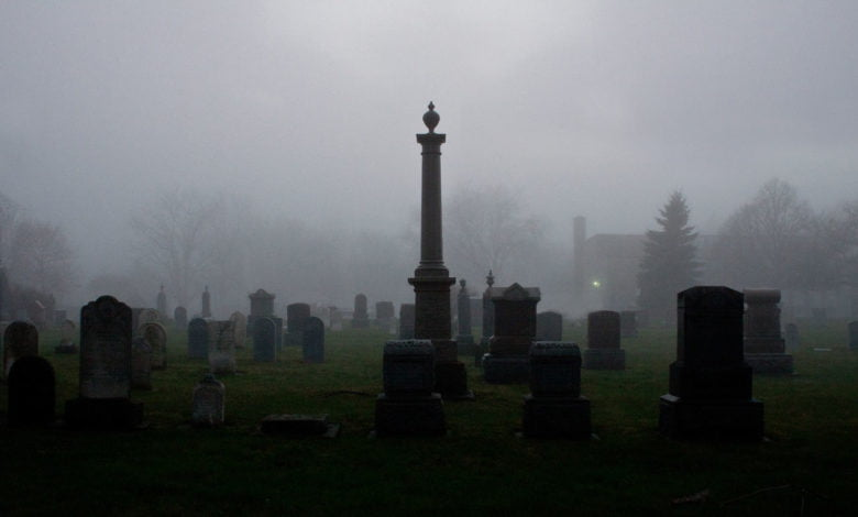 A cemetery shrouded in fog