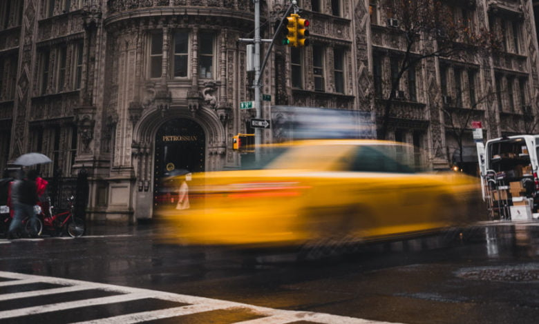 A car drives by in downtown New York City