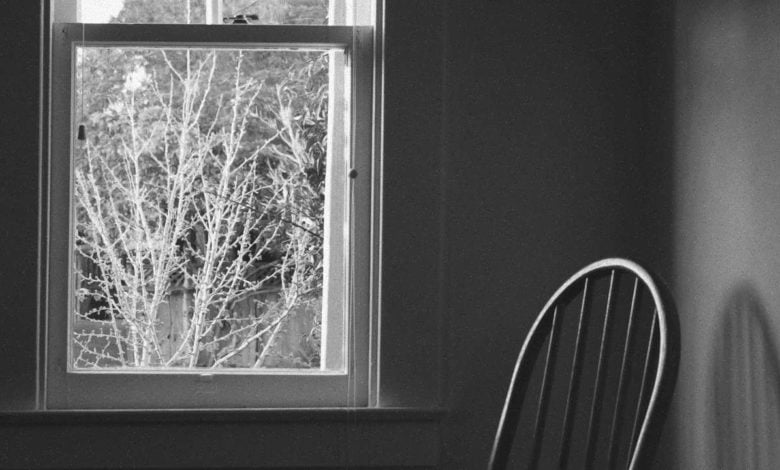 a chair by a window