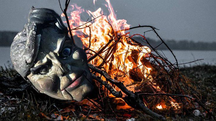 a bonfire and a doll's head