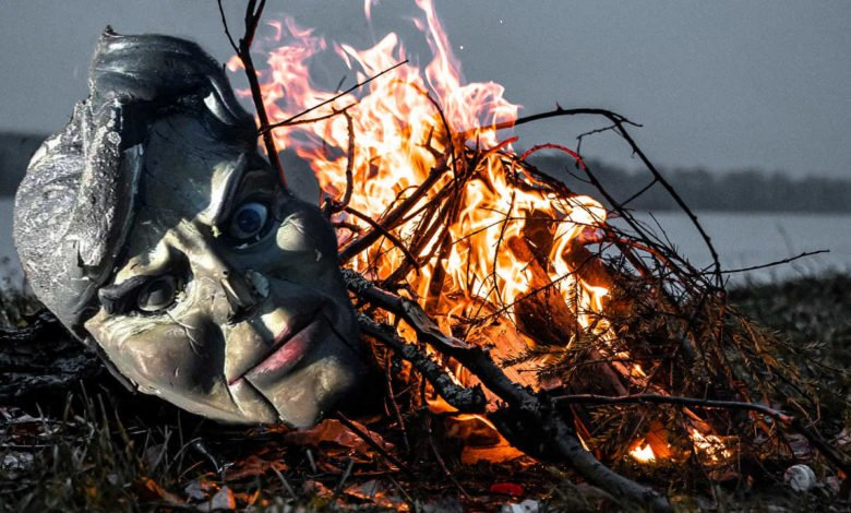 a bonfire and a doll's head