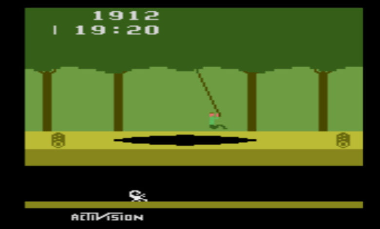 Screencap of Pitfall! on Atari 2600; Pitfall Harry swings on a rope