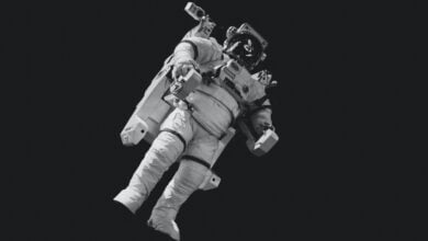 An astronaut floating in space