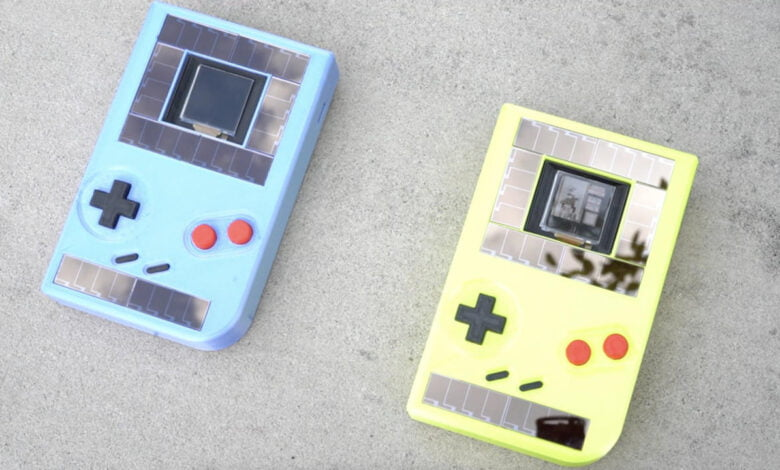 Two sustainable Game Boys, one blue one yellow