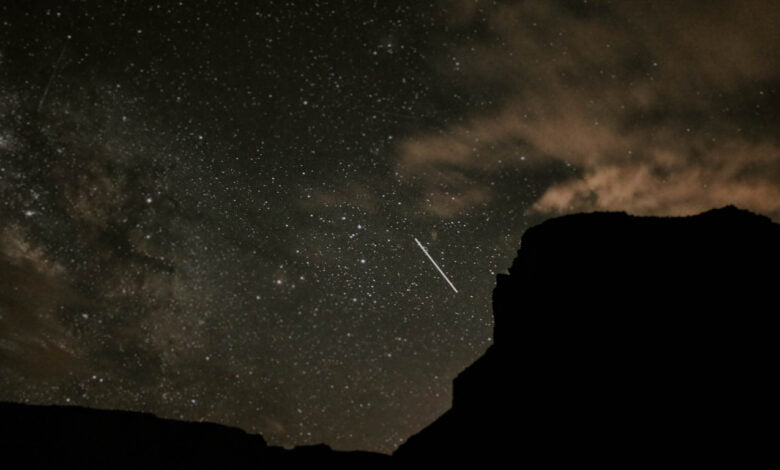 The Utah desert at night and a shooting star