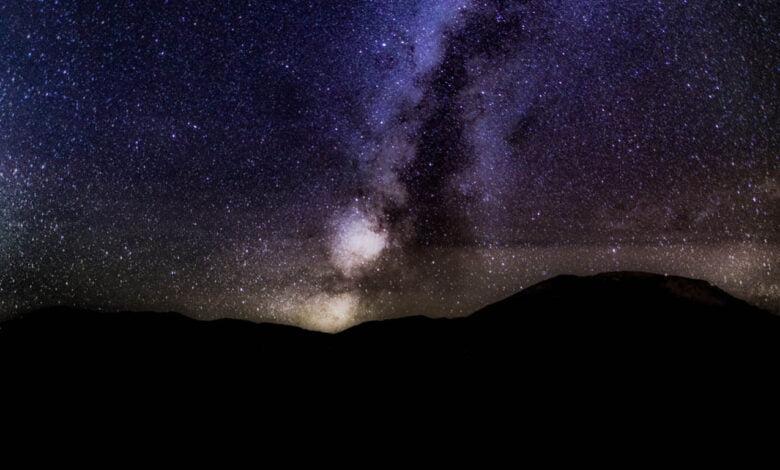 A starry sky over a mountain range