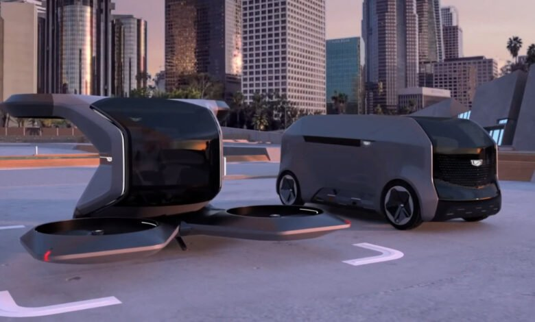 The single-seat GM air taxi next to the other thing
