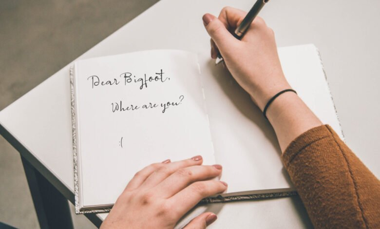 A woman writing a note to Bigfoot