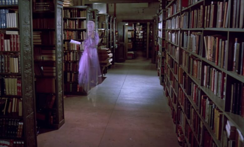 The library ghost tries to read a book