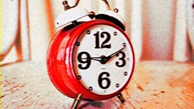 A red alarm clock
